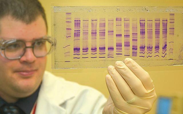 A U.S. Customs and Border Protection chemist reads a DNA profile. (James Tourtellotte/Common domain via Wikipedia)