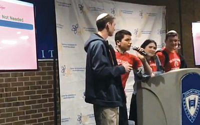 Members of the hackathon team from the Frisch School of Paramus describe their winning monitor device for the elderly.
