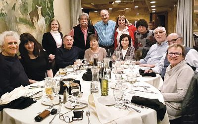 Members of the Reform Temple of Rockland's car club and their wives meet for dinner.
