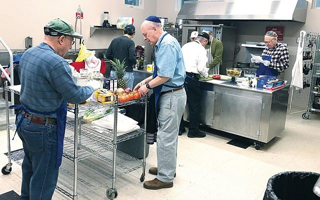 Men Who Cook are pictured in Congregation Sons of Israel in Upper Nyack preparing a kiddush.