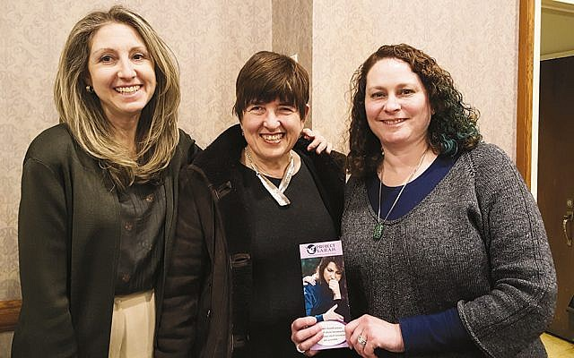 Maxine Harelick, left, and Arlene Bernhardt, NCJW programming vice presidents, flank Esther East, executive director of Project Sarah. (Courtesy NCJW)
