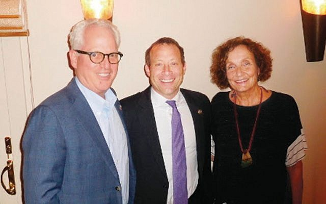 Congressman Josh Gottheimer, center, is flanked by Bob and Sarah Goodman. (Courtesy Norpac)