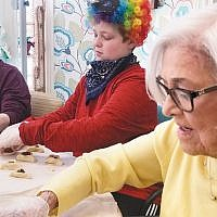 Residents of the Bristal Assisted Living in Woodcliff Lake celebrated Purim by baking hamantaschen with seventh graders from Valley Chabad Hebew School, who also performed a play for them on March 17. (Courtesy Chabad)
