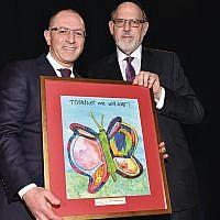 Gilles Gade, left, president and CEO of Cross River, receives the 2019 Community Partnership award from Sinai's board chairman, Rabbi Mark Karasick.