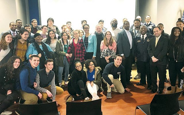 Some students and speakers stand together, both literally and metaphorically.	(Simon Wiesenthal Center)