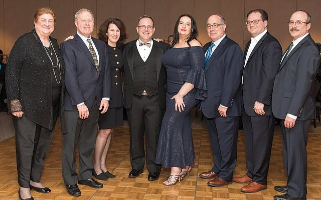 Rabbi David and Alla Fine, center, with Temple Israel & JCC board members, from left, financial secretary Merille Siegel, vice presidents Howard Schreiber and Nadine Genet, president Robert Obeiter, treasurer Evan Weitz, and recording secretary Manny Haber. (Robert Kern)
