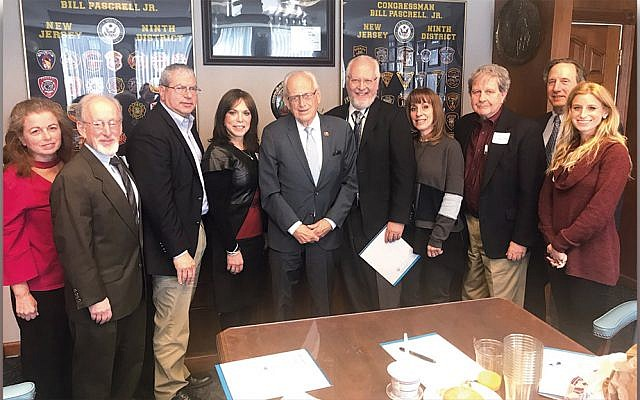 From left, Martha Cohen, Jewish Community Relations Committee chair Stan Goodman, Bruce Brafman, Mindy Stein, Congressman Bill Pascrell, Rabbi Paul Zucker, Barbara Selman, Ron Rosensweig, Richard Schnaittacher, and JCRC director Ariella Noveck. (Courtesy JFNNJ)