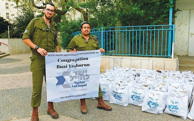 Several hundred Pesach food packages distributed to IDF soldiers came from New Jersey, including from Congregation Bnai Yeshurun in Teaneck, which sent 60 packages to Netzach Yehuda. (Photo provided)