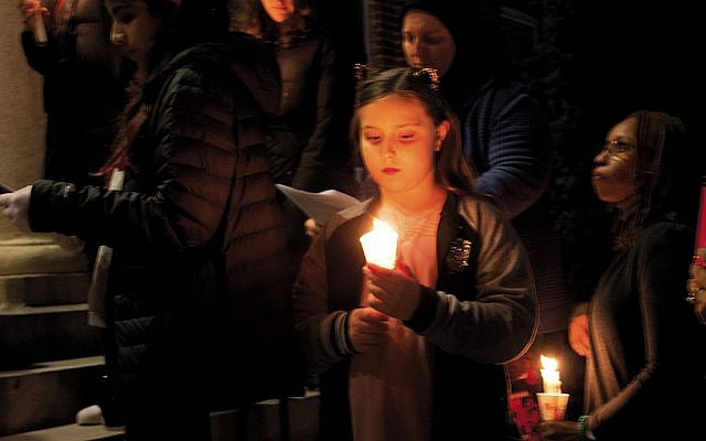 The candlelight vigil in Teaneck remembering the victims of the massacres at New Zealand mosques reflected solemnity and solidarity by mourners of all ages. (Photos by Steve Fox)