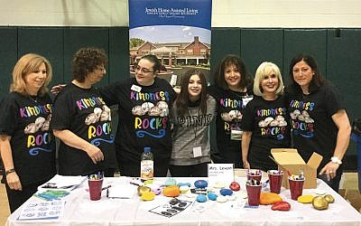 River Vale's Jewish Home Assisted Living staff and residents visited the town's middle school to share the Kindness Rocks project at its career fair. (Courtesy Jewish Home Family)