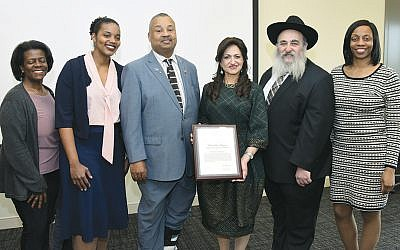 Councilwoman Patricia Perkins-Auguste, left, with Hillside's Mayor Dahlia Vertreese, Congressman Donald Payne, Shterney and Rabbi Mordechai Kanelsky, and Union County Freeholder Angela Garretson. (Courtesy BA)