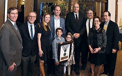 Rabbi Arthur Weiner of the JCC of Paramus/Congregation Beth Tikvah, left, with the executive director of Israel Bonds New Jersey, Lee Schwartz; Congregation Beth Tefillah honorees Shira and Jeremy Spier and their children Jonah and Ava; Israeli's Ambassador Ido Aharoni; Rabbi Daniel Wolff of Congregation Beth Tefillah; JCCP/CBT honoree Miriam Levin, and Israel Bonds Bergen County's registered representative, Marc Rosen. (Jeff Karg)