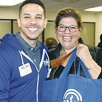 Adrian Diaz and Sarita Gross at the March 31 food drive
