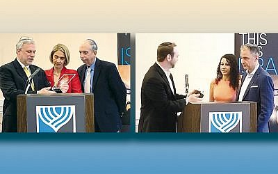Rabbi David Berkman, of the NCJC, left, with Beth and Gary Israel. (Craig Wertheim) Rabbi Jeremy Ruberg, left, of the New City Jewish Center, with Eszter and Peter Friedman.