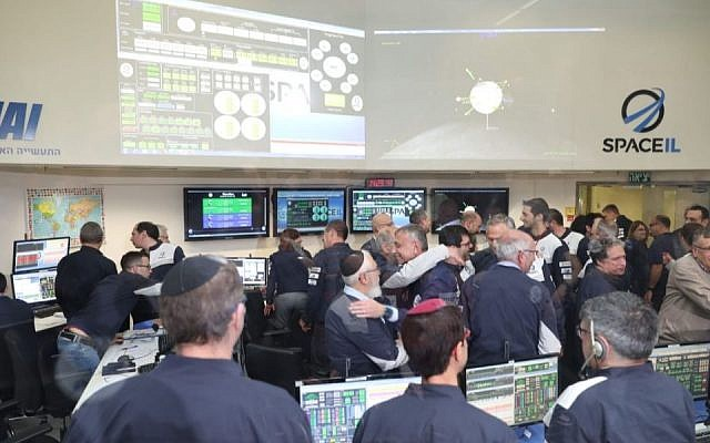 SpaceIL and Israel Aerospace Industries engineering teams celebrate after the six-minute maneuver that brought the Beresheet spacecraft into the moon's orbit. (Eliran Avital)
