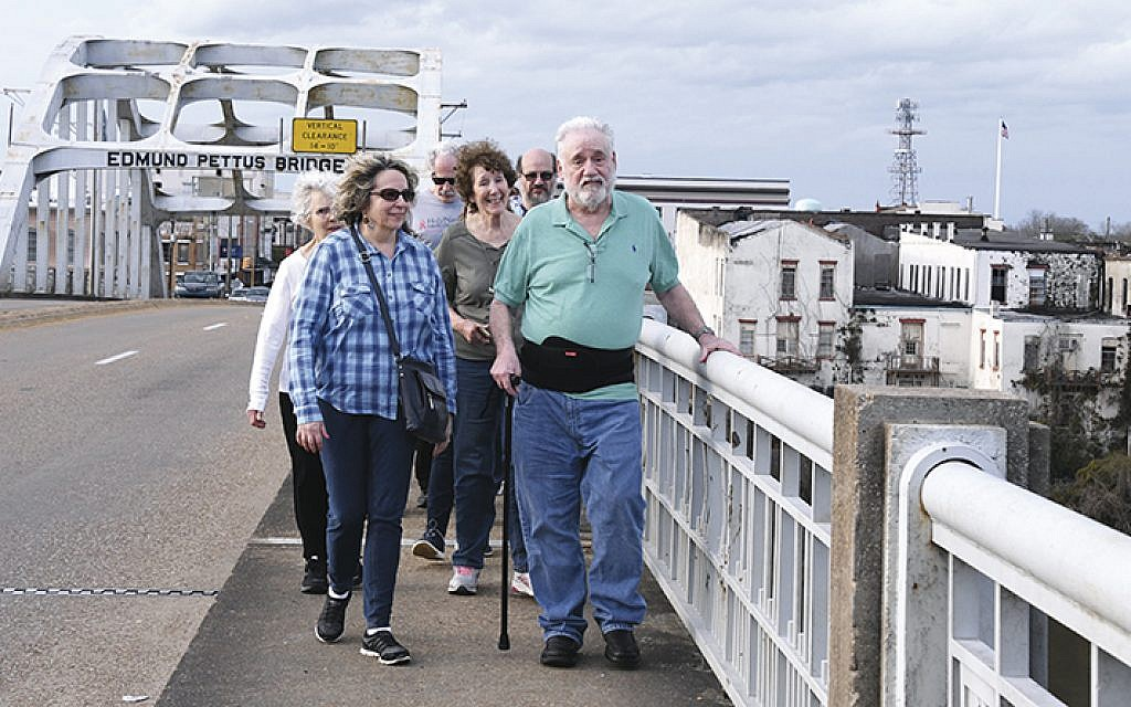 A group from Temple Emeth walks in the footsteps of the Bloody Sunday civil rights protestors, who crossed the Edmund Pettus Bridge and were beaten by the police massed on the other side. The bridge is a seminal place in civil rights history (ARBARA BALKIN)