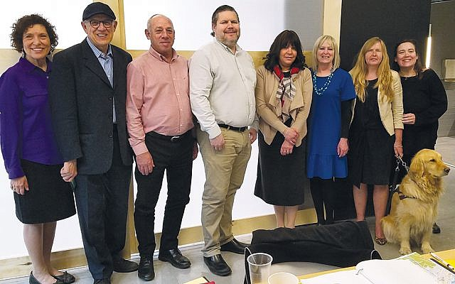 The group from the JIB visits the Canadian National Institute for the Blind's Community Hub in Ottawa. From left, Dianne Bekritsky of Teaneck, a member of JIB's executive board; Les Breiner of the Canadian Friends of JIB; Shabtai Deutch, JIB's director-general; Duane Morgan, CNIB's executive director; JIB's principal, Menucha Trop; JIB's deputy director, Rachel Skrobish; Diane Bergeron, vice president of the CNIB Foundation; and Cathy Radnor of CNIB. Ms. Bergeron is holding the leash of her guide dog, Lucy.