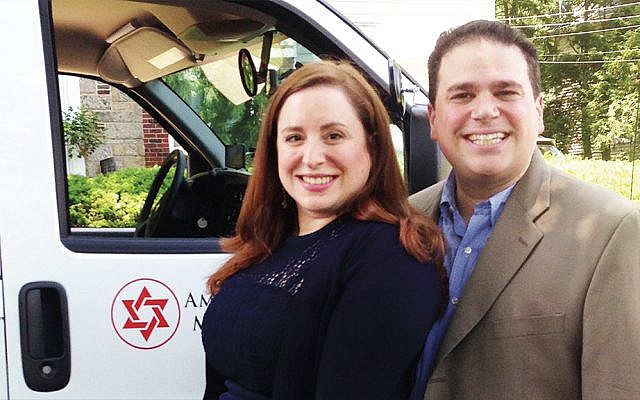 Esther and Elie Katz of Teaneck stand alongside an ambulance funded by American Friends of Magen David Adom for use in Israel.