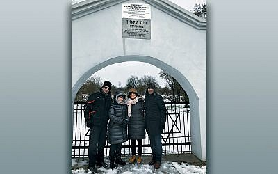 From left, Dr. Zvi Marans, Nina Kampler, Rabbi Amy Roth, and Rabbi Noam Marans stand outside the gates of the Treblinka death camp in Poland.