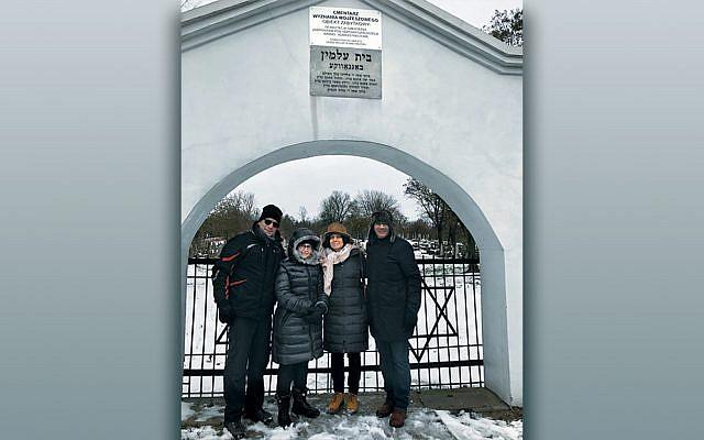 From left, Dr. Zvi Marans, Nina Kampler, Rabbi Amy Roth, and Rabbi Noam Marans stand outside the gates of the Treblinka death camp in Poland.