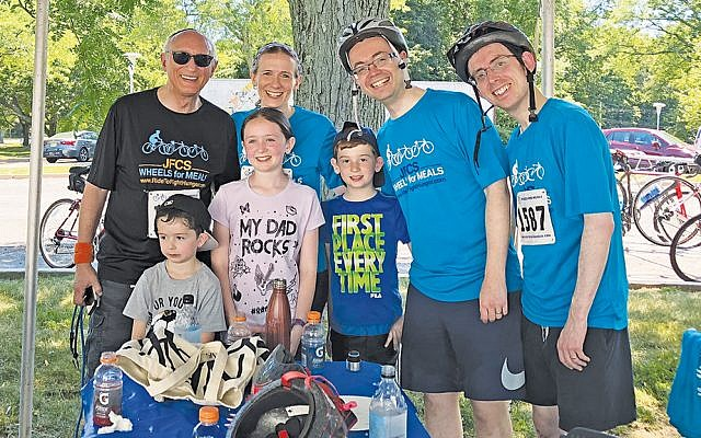 At last year's Ride to Fight Hunger. From left, Nesya Bayewitz's grandfather, Jacob Schlanger; mother, Tirza Bayewitz; father, Ariel Bayewitz, and uncle, Ashrei Bayewitz. Kids, from left: Nesya's brother, Sammy, Nesya, and brother, Moshe.