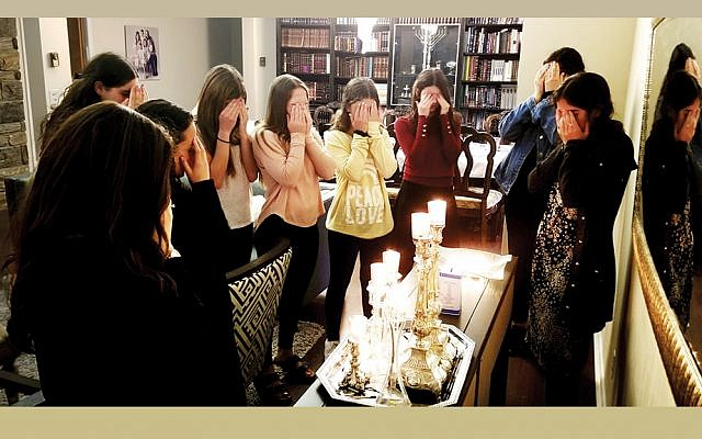 Candles are lit before a special Shabbat Friday night dinner to honor the life of Lori Gilbert-Kaye. (Valley Chabad)
