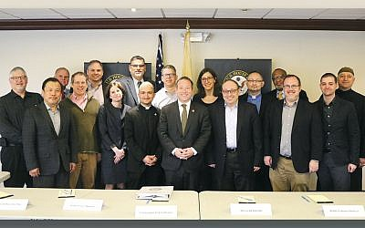 Leaders at the meeting included Rabbi Loren Monosov, front row, fourth from left and Cantor Alan Sokoloff, behind her in the back row, left of the U.S. flag, both of Temple Emanuel of the Pascack Valley in Woodcliff Lake; Congressman Josh Gottheimer, front row, center; and to his right, Rabbis Nathaniel Helfgot, Congregation Netivot Shalom of Teaneck, and David Fine, Temple Israel & JCC in Ridgewood. Rabbi Rachel Steiner of Barnert Temple in Franklin Lakes is behind them. (Photo provided)