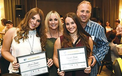 Jessica and Amanda Leichter of Woodcliff Lake with their parents and awards at last year's gala. (GM Studios)