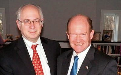 Dr. Ben Chouake, left, and Senator Chris Coons (D-Del.) (Courtesy Norpac)