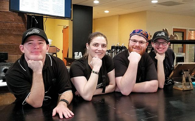 Four of the employees of Lillian's Café, which just opened in the lobby of the JCC Rockland in West Nyack. The young men are on the autism spectrum.