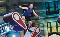 Jimmy Choi, 43, who was diagnosed with early onset Parkinson's, shows his agility during the competition as an American Ninja Warrior.