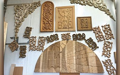 The handiwork of Lavi Furniture Industries is displayed on the wall of the showroom at its factory in eastern Galilee.