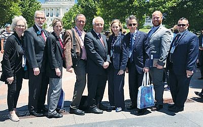From left, Simone Wilker, Rabbi David Zuckerman, Rabbi Paula Mack Drill, Richard Schnaittacher, Alain Sanders, Leslie Levinson, Allen Levinson, Matan Kogen, and NJ-AJC's development director, Morgen Kronenberg, stand together in Washington. (Courtesy AJC)