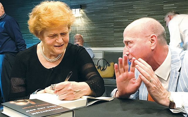 Professor Deborah Lipstadt signs a book for Gary Siepser, CEO of Jewish Federation & Foundation of Rockland  County. (Photo provided)
