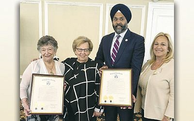 From left, Gladys Laden, State Senator Loretta Weinberg, State Attorney General Gurbir A. Grewal, and Assemblywoman Valerie Huttle. Ms. Laden and Mr. Grewal hold the plaques they received from the New Jersey Legislature. (Photos courtesy NCJWBCS)