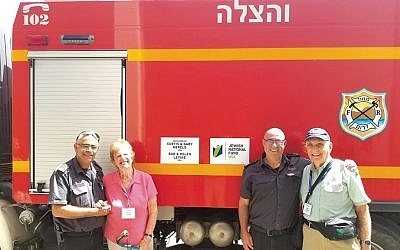 Yuval Kalmanovich, head of operations for firefighting and rescue at the Be'er Sheva Regional Station; Helen Levine; Shmulik Friedman, chief of operations for Israel Fire and Rescue Authority, and Bob Levine. (Courtesy JNF)