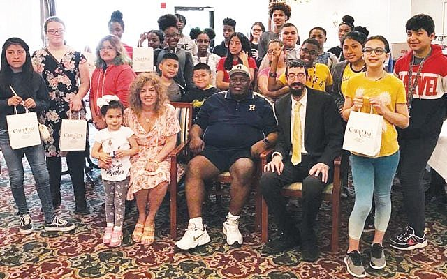 From left, among the participants, are Charlotte Sodora, the administrator of CareOne at Wellington in Hackensack; Hackensack's Deputy Mayor David Sims; and Rabbi Mendy Kaminker of Chabad of Hackensack. (Courtesy Chabad)