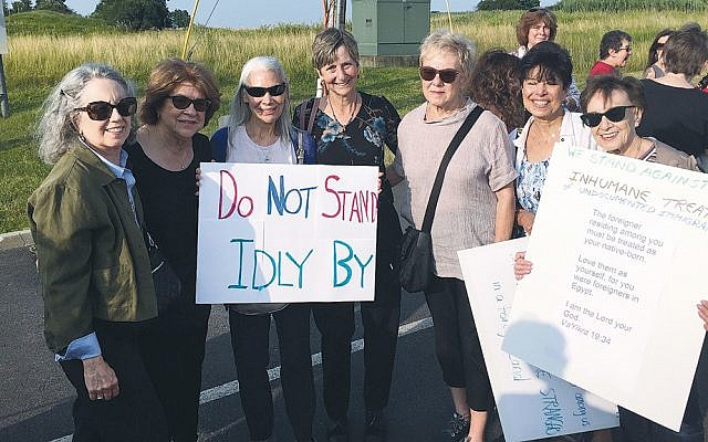 Orangetown Jewish Center members at the protest include, from left, Ellen Abramson, Gloria Brettner, Bonnie Ben Pilar, Rabbi Paula Mack Drill, Adele Garber, Lorraine Brown, and Carmel Rosenthal.