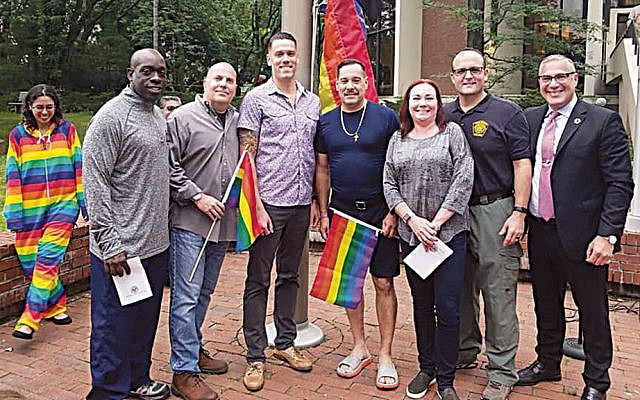 Michael Wildes, right, with members and support staff of the Englewood police department.