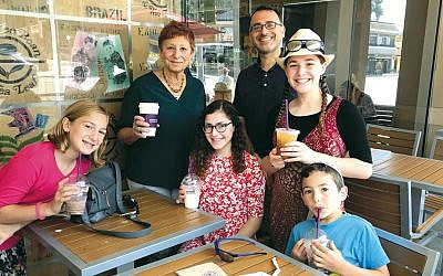 Many Resnicks are together for coffee — from left, it's Nitzan, 8; Judi; Maytal, 15; the kids' father, Judi's son Benjamin; Maayan, 17, and Noam, 8.