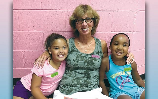 Carol Fertig sits between two of her reading buddies.