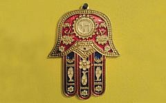 The hamsa — this modern version was made in Venezuela — is an amulet Jews wear to ward off the evil eye. (Wikimedia Commons)