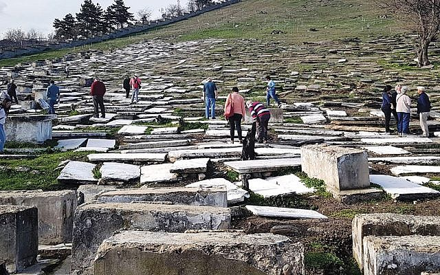 Visitors tour the Jewish cemetery of Bitola, North Macedonia, in 2018. (Yael Unna/Wikimedia Commons)