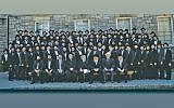 Rabbis Avrohom H. Levin and Chaim Schapiro, associate dean Rabbi Mendy Herson, former Ashkenazi chief rabbi of Israel Meir Lau, dean Rabbi Moshe Herson, Rabbi Yitzchok Yehudah Yeruslavsky, trustee Jed Katz, and Rabbi Aaron Dovid Gancz are in the front row with the graduates. (Photos courtesy RCA)