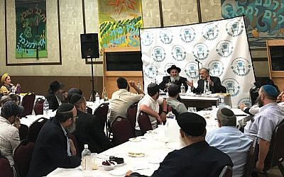 Rabbi Mordechai Kanelsky at the head table, left, with Moshe Markovitz of Teaneck.