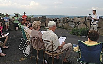 Rabbi David Widzer leads a service on the Palisades last year. (Courtesy Kol Dorot)