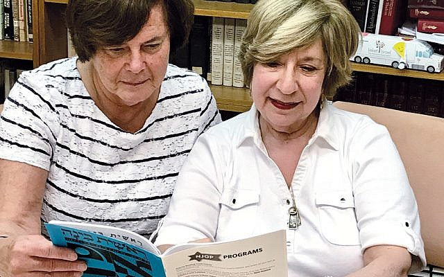 Deborah Barcan, left, a Hebrew teacher at Temple Emanuel of the Pascack Valley in Woodcliff Lake, assists student Karen Albert with her Hebrew reading skills in a  recent class. (Courtesy TEPV)