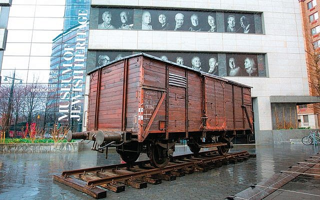 A freight car used to transport Jews to Auschwitz is positioned in front of the museum of Jewish Heritage — A Living Memorial to the Holocaust.