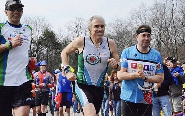 John Rinaldo, Larry Grogin, and Eric Geller run to Boston, on their way to the marathon there, in 2014.