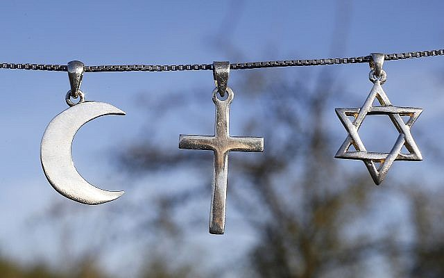 From left, the symbols of Islam, Christianity and Judaism. U.S. Jews know more about religion in general than their non-Jewish neighbors, Pew found. (Godong/Universal Images Group via Getty Images)